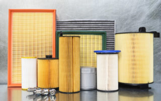 various car filters replaced during auto repair maintenance check